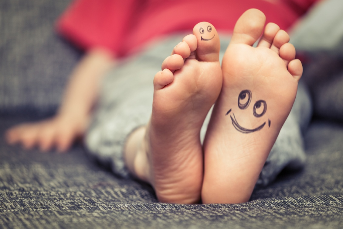 kids feet image with smiley face